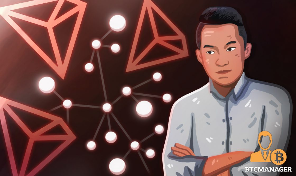 justin sun in front of lights and tron