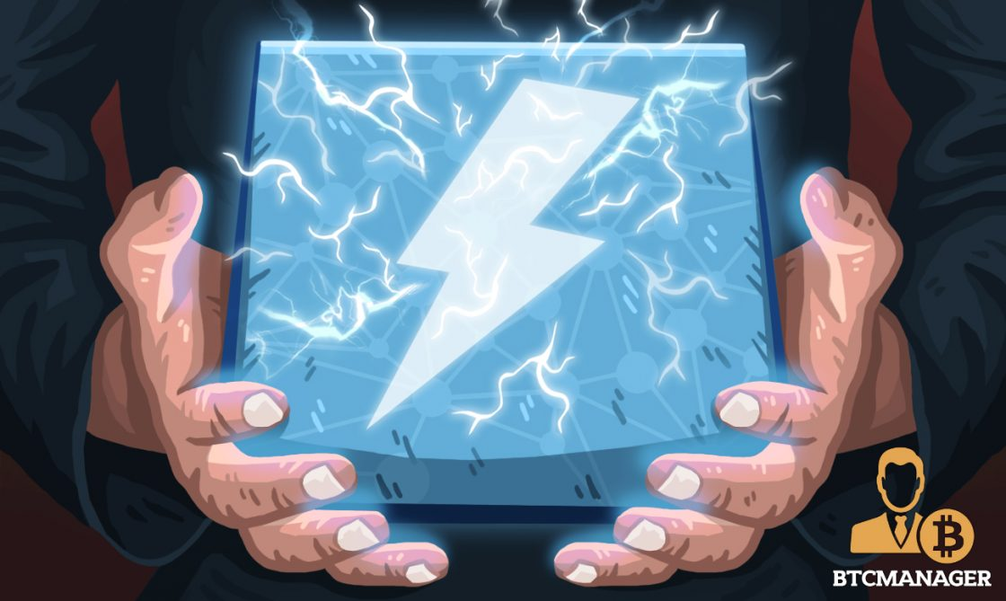 Two Hands Holding a Block with a Lightning Bolt inside
