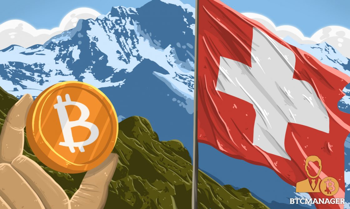 Hand Holding a Bitcoin and the Swiss Flag